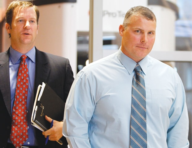 In this Oct 4, 2011 file photo former CIA contractor Raymond Davis (right) arrives at the Douglas County Courthouse in Castle Rock for a hearing on a felony assault charge.—AP