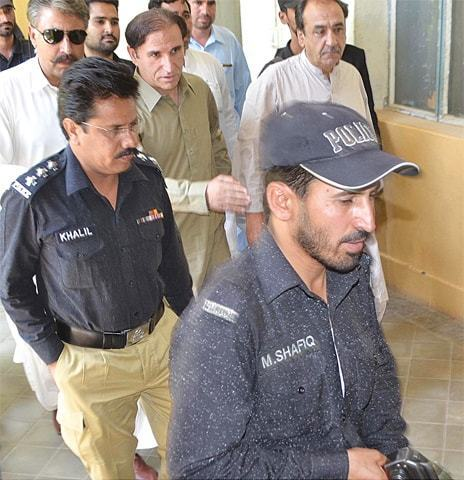 QUETTA: Pakhtunkhwa Milli Awami Party MPA Abdul Majeed Khan Achakzai being produced in court on Saturday.—INP