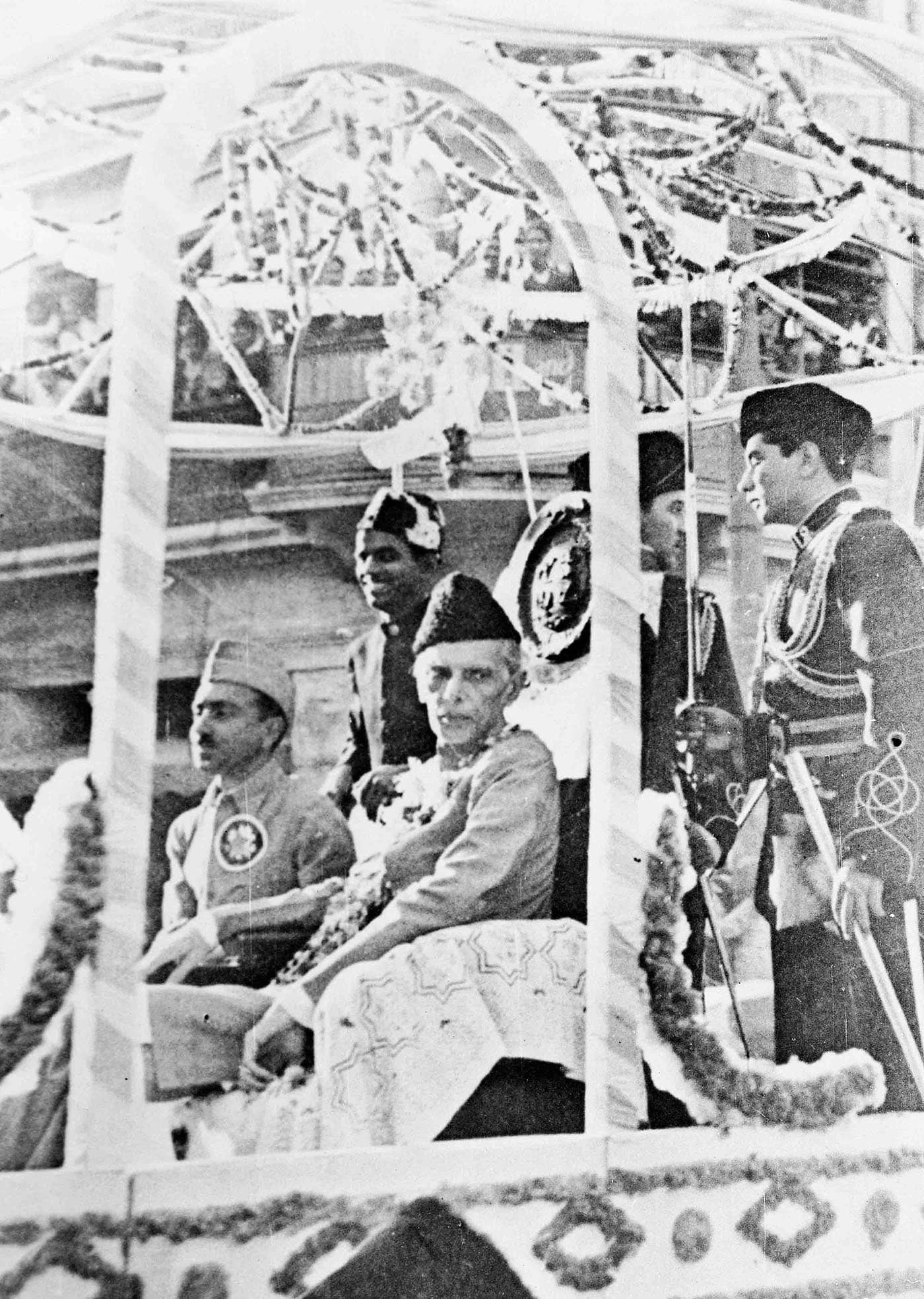 The Quaid-i-Azam, Mohammad Ali Jinnah and G.M. Syed make their way in a triumphal procession to the Annual Session of the Muslim League in Karachi in December 1943. — Courtesy National Archives Islamabad