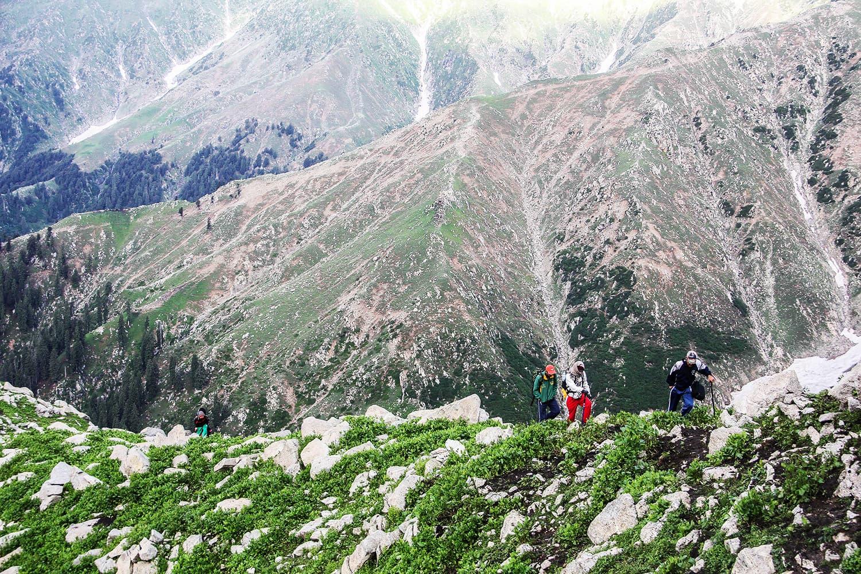 Tourists climb a narrow ridge to reach Saidgai Lake.—Fazal Khaliq