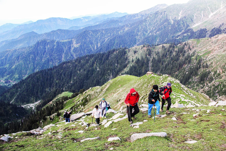 Tourists climb a steep ascent to reach Saidgai Lake.—Fazal Khaliq