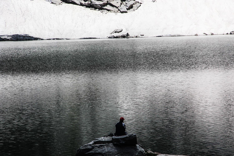 A tourist enjoys the serenity of Saidgai Lake.—Fazal Khaliq