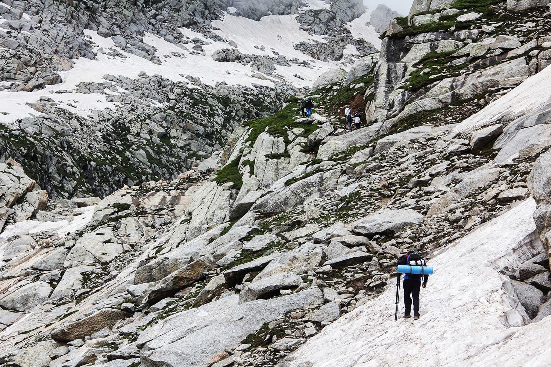 Tourists cross some dangerous ridges to reach Saidgai Lake.—Fazal Khaliq