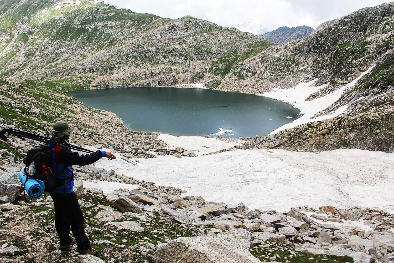 A tourist looks at the beautiful Saidgai Lake.—Fazal Khaliq