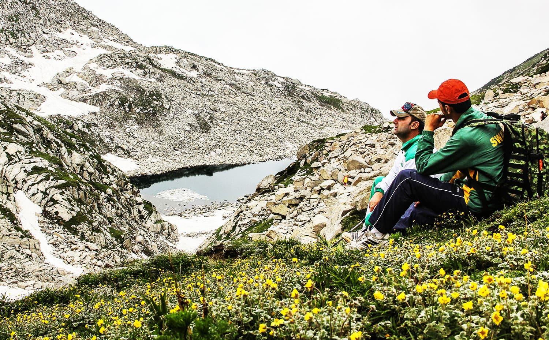 Tourists enjoy a beautiful view above Kangar Lake.—Fazal Khaliq