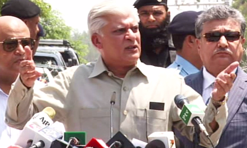 PM's Special Asst Asif Kirmani speaks to reporters outside the JIT secretariat. ─ DawnNews