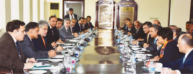 FINANCE Minister Ishaq Dar pictured during his meeting with presidents and chief executive officers of various banks on Thursday.—PPI