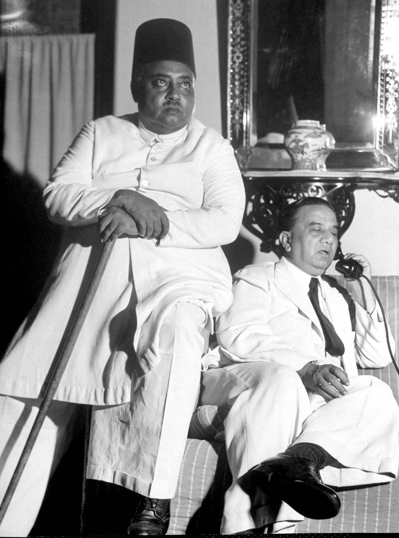 It is the eve of Direct Action Day. Bengal Premier, Huseyn Shaheed Suhrawardy (right), is engrossed in a telephone conversation at his residence in Calcutta. Khawaja Nazimuddin, his predecessor, is seated next to him. — Excerpted with permission from Witness to Life and Freedom, Roli Books, Delhi