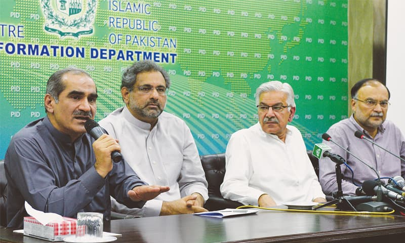 FEDERAL Ministers Khawaja Saad Rafiq, Shahid Khaqan Abbasi, Khawaja Muhammad Asif and Ahsan Iqbal address a press conference at the PID on Saturday.—Photo by Tanveer Shahzad / White Star