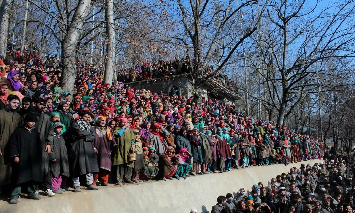 People attend a funeral procession of a militant killed by Indian forces in January 2015 in southern Kashmir's Aglar area
