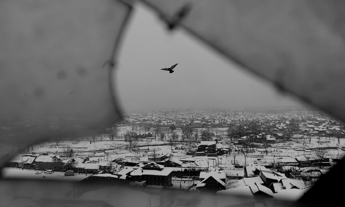 A view of downtown Srinagar from a broken window of the Makhdoom Sahib Shrine