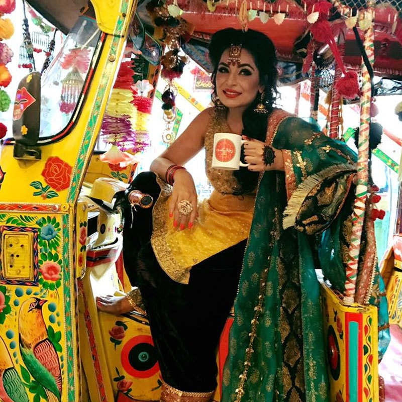 Meera posing inside the yellow rickshaw outside the cafe. Photo: ChaiKadaIsb/Facebook