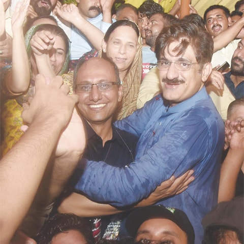 A VICTORIOUS Saeed Ghani celebrates with Sindh Chief Minister Murad Ali Shah.—PPI