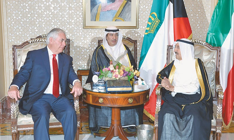 Kuwait's Emir Sheikh Sabah al-Ahmad al-Sabah with US Secretary of State Rex Tillerson in Kuwait City on Monday.—AFP