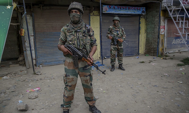 Indian army soldiers stands guard at the site of shootout in Batengoo about 50 Kilometres south Srinagar.─AP