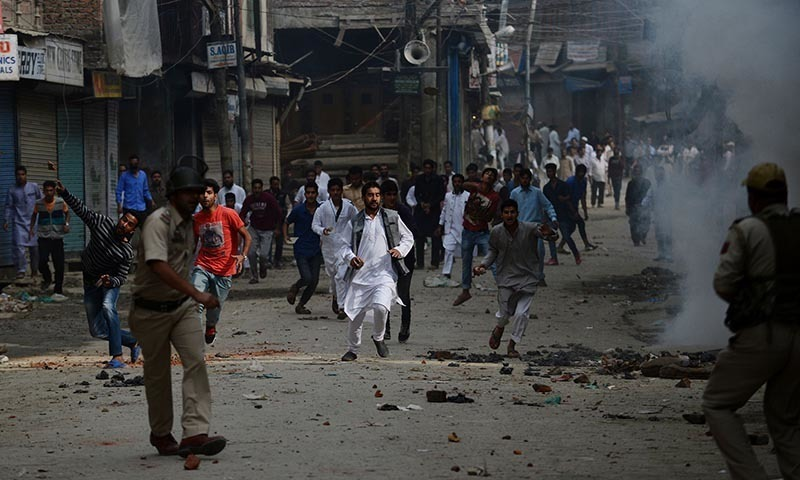 Despite curfew, people pelt stones at police forces. - File