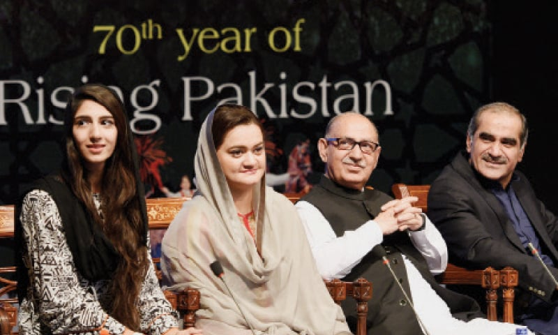 Minister of State for Information Marriyum Aurangzeb, PM's Adviser Irfan Siddiqui and Railways Minister Saad Rafique sit with Saba Zaman who won the logo competition. — Photo by Tanveer Shahzad