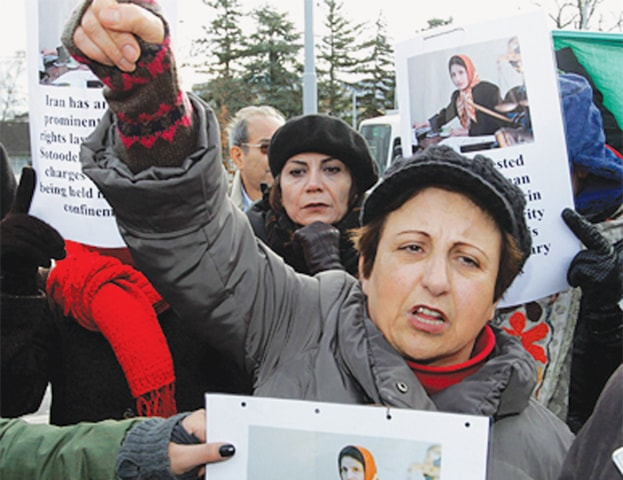 Shirin Ebadi protesting in Geneva for the release of an Iranian activist. At 28 years of age, Ebadi was appointed the first woman to head Tehran's city court. Four years later, after the 1979 revolution, she was forced to resign as the clerical regime forbade women from serving as judges. In 2003, she became the first Muslim woman to be awarded the Nobel Peace Prize. | AP