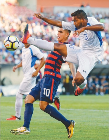 CLEVELAND: Nicaragua's Bryan Garcia (R) vies for the ball with Joe Corona of the United States during their CONCACAF Gold Cup match.—AP