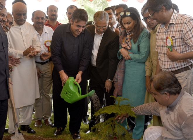 ISLAMABAD: PPP chairman Bilawal Bhutto-Zardari pours water after planting a tree at the National Press Club on Monday.—Photo by Tanveer Shahzad / White Star