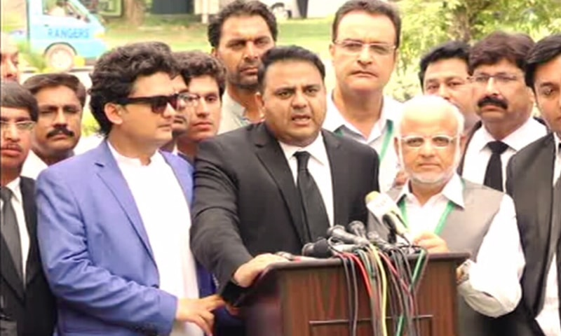 PTI's Fawad Chaudhry speaking outside the SC.─ DawnNews