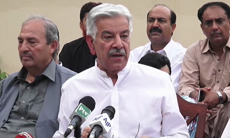The Defence minister speaks to the media in Sialkot on July 22 — DawnNews