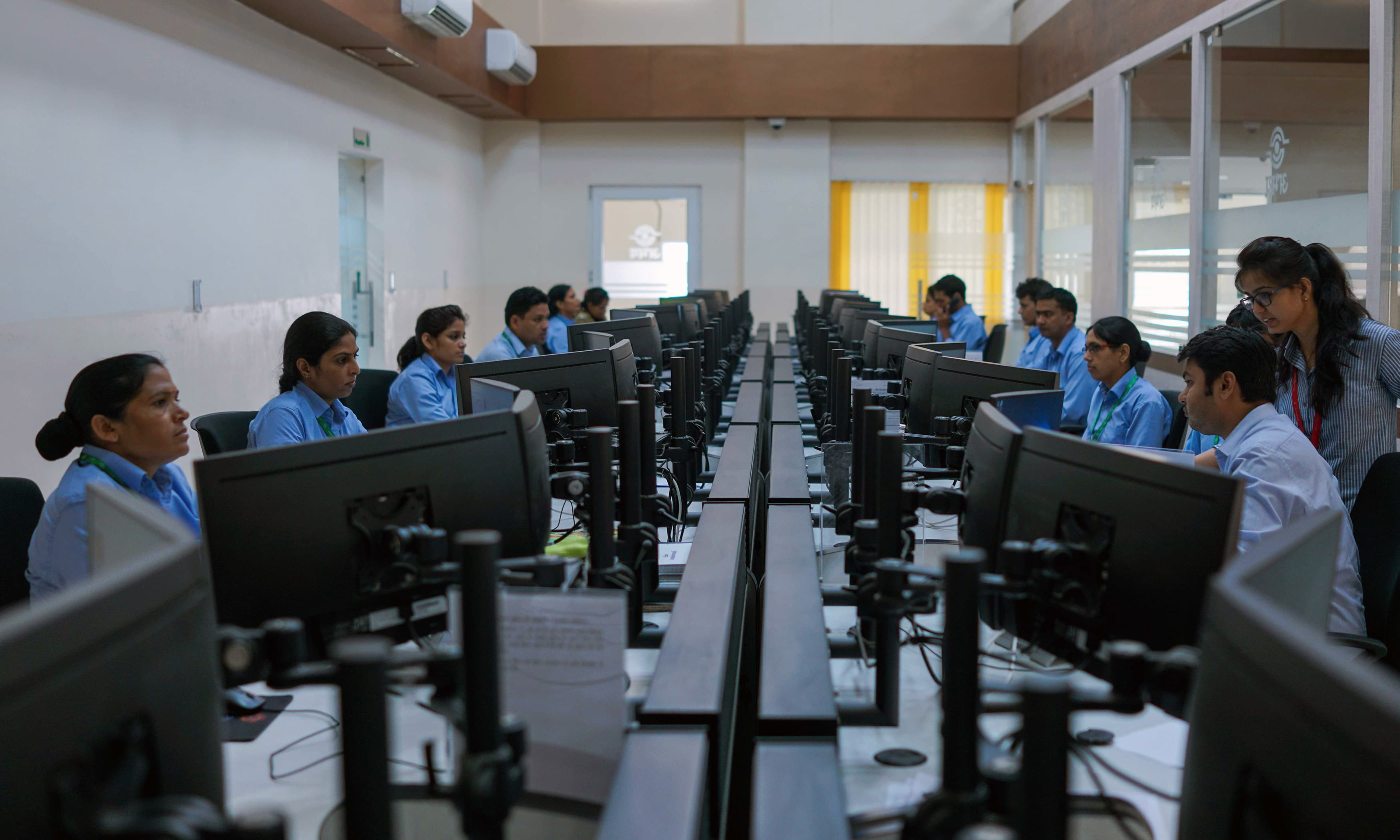Indian police officials work inside the police command centre at Jaipur Commissionate Headquarters in Jaipur. —AFP