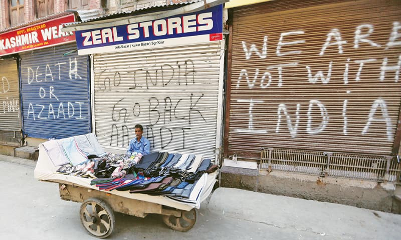 SRINAGAR: A vendor waits for customers during a strike on Tuesday.—Reuters