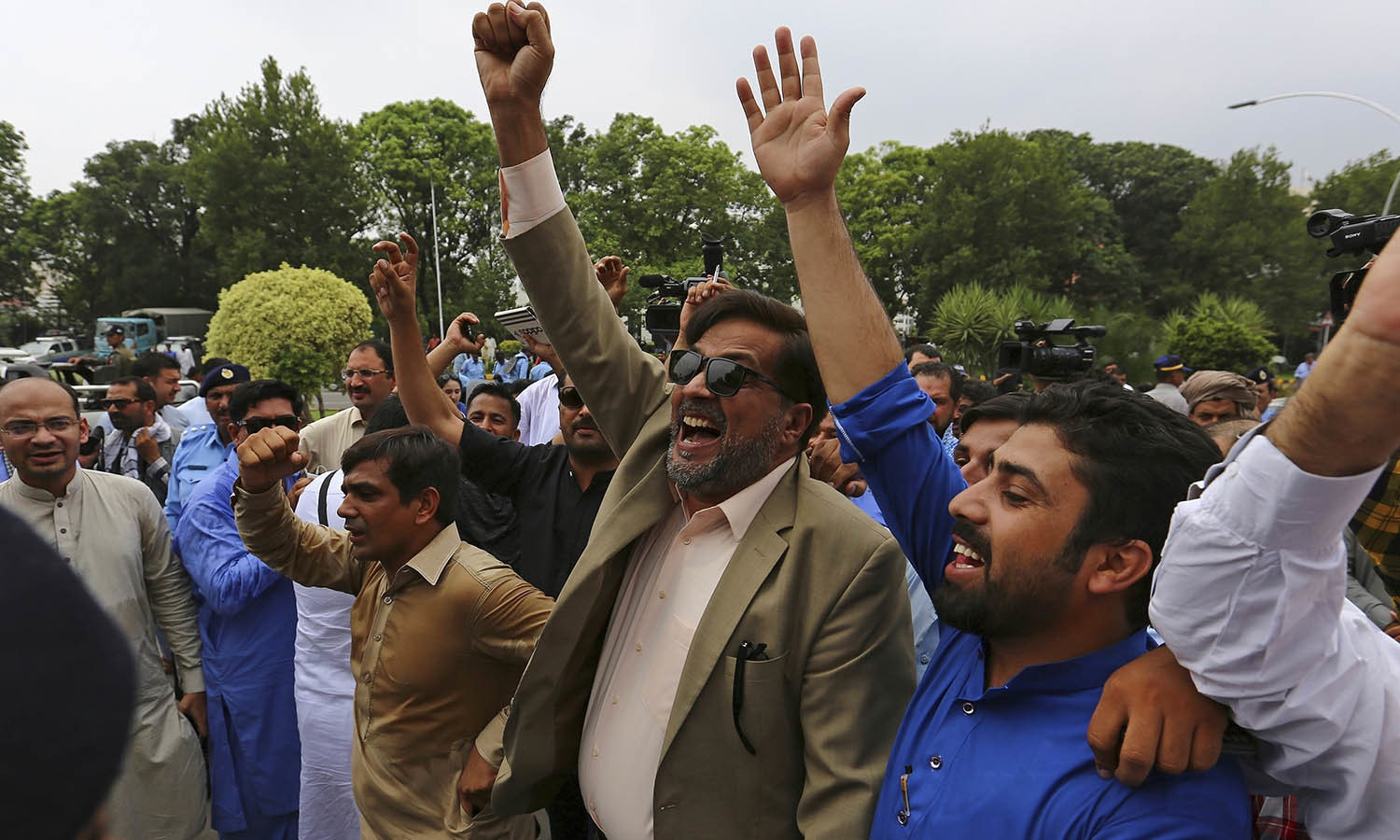 People celebrate the dismissal of PM Nawaz Sharif. —AP