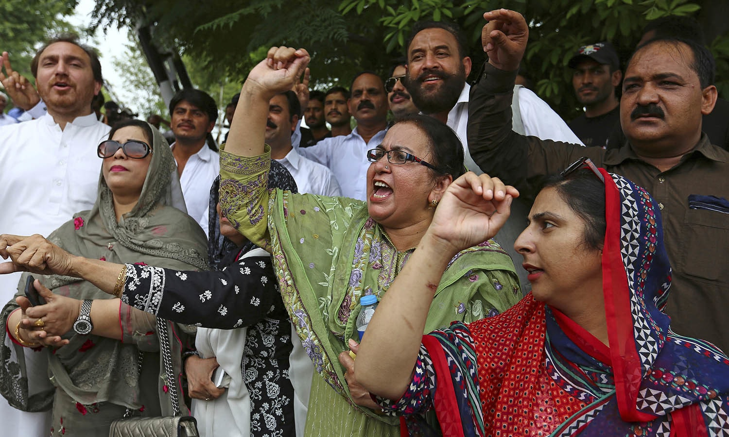 Opponents of PML-N shout slogans after the Supreme Court's decision to disqualify Nawaz Sharif. —AP