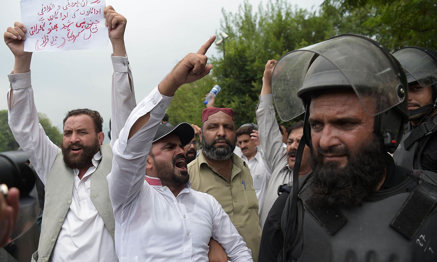 Supporters of ousted PM Nawaz Sharif shout slogans against opposition leader Imran Khan in Islamabad. —AFP