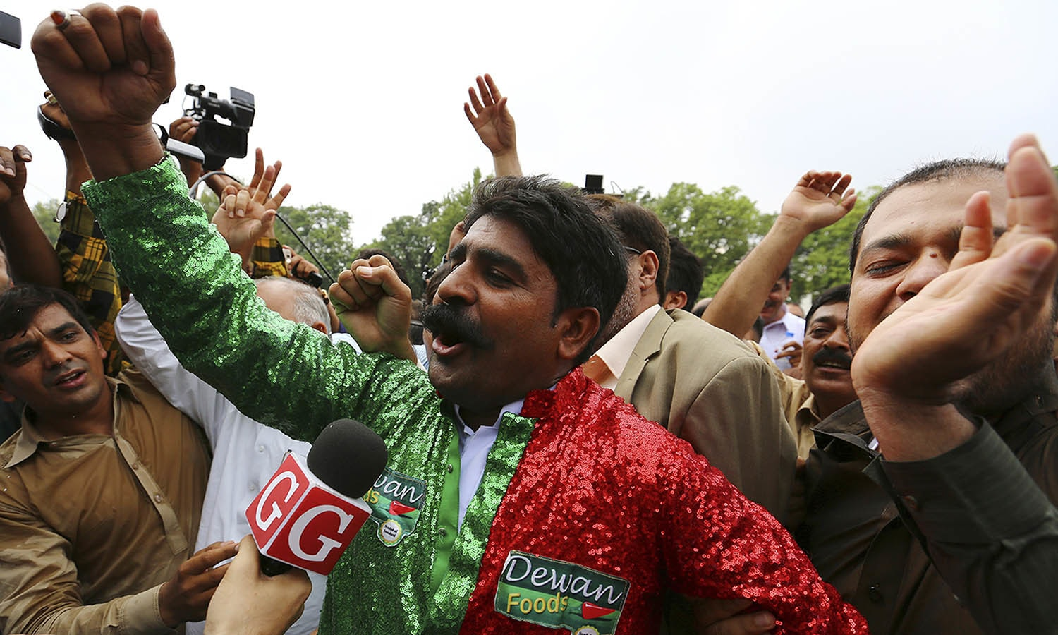 PTI supporters celebrate the dismissal of Nawaz Sharif outside the Supreme Court in Islamabad. —AP
