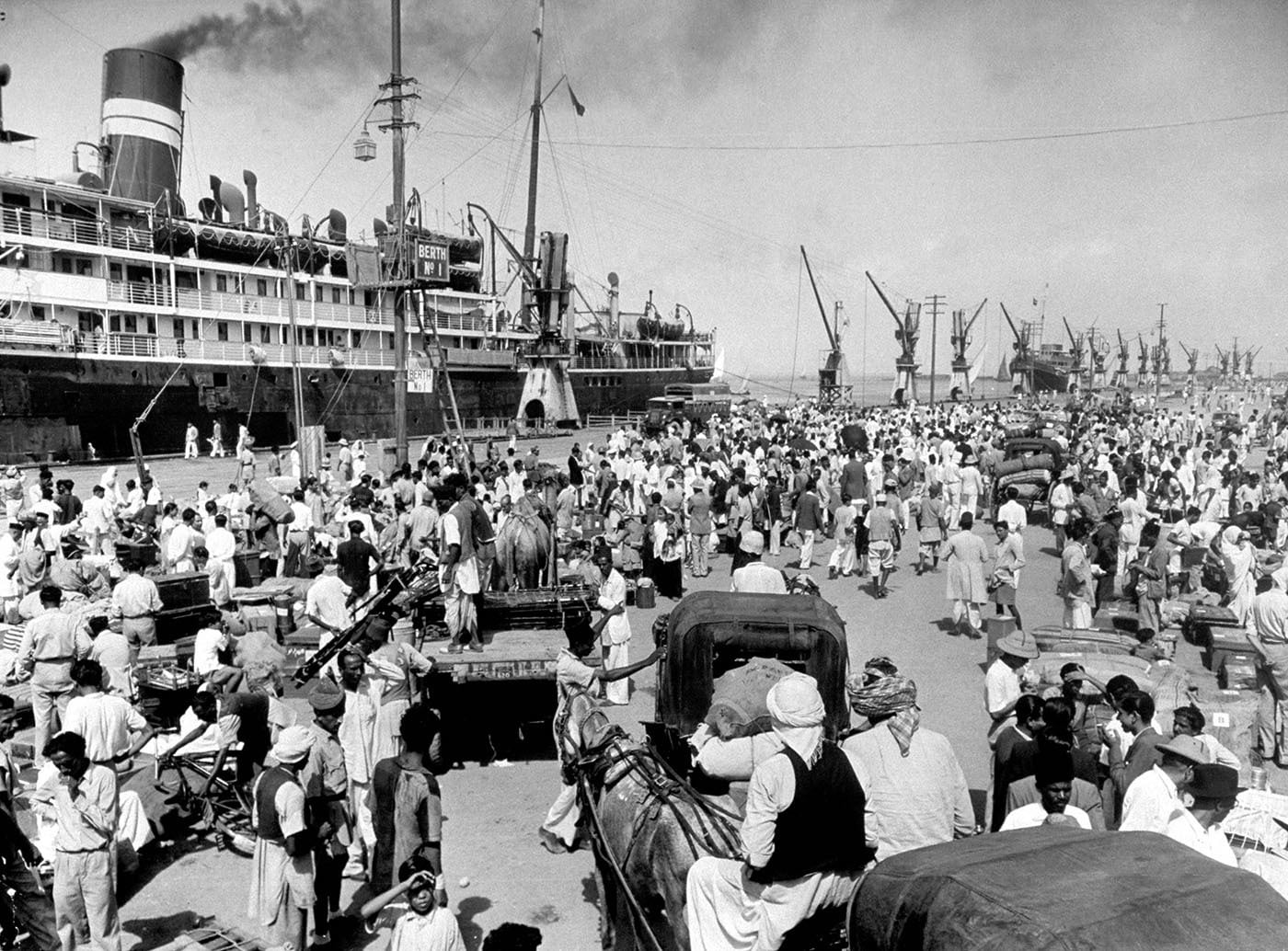 Hindu refugees wait to board ship at Karachi Harbour and embark for Bombay. — Excerpted with permission from Witness to Life and Freedom, Roli Books, Delhi
