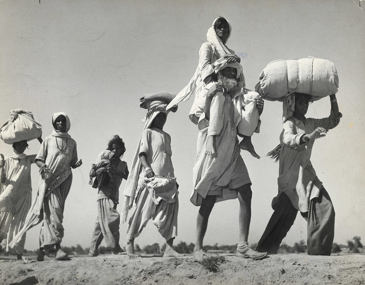 Too weak to walk on her own, a woman sits on her husband's shoulders as Sikhs and Hindus brave the unforgiving October heat during their migration to eastern Punjab from Lahore.— Excerpted with permission from Witness to Life and Freedom, Roli Books, Delhi