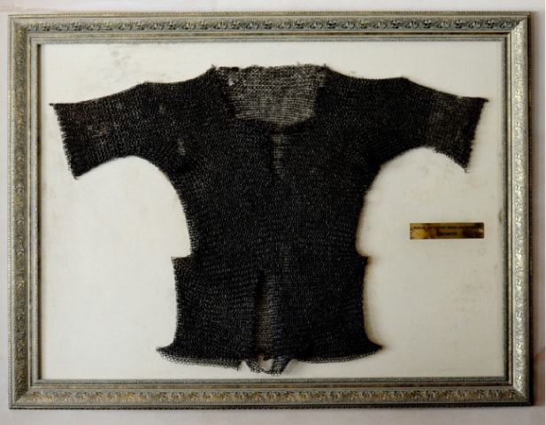A brass armour shirt from the Mughal era, known as zirah baktar, is displayed in the Gun and Country Club dining hall.