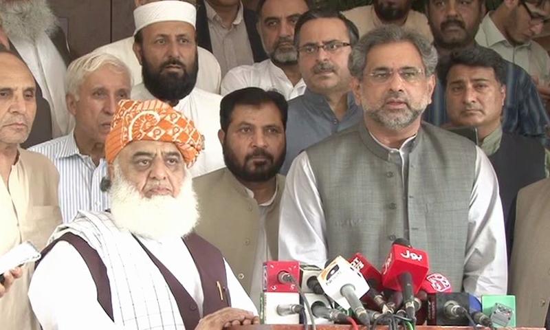 Former petroleum minister and PML-N's nominee for interim prime minister, Shahid Khaqan Abbasi, speaks to the media alongside Maulana Fazlur Rehman.—DawnNews screengrab