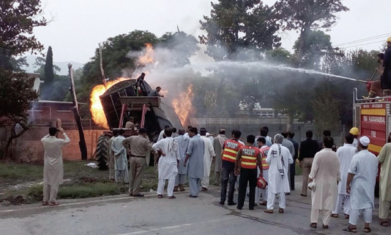 Six burnt to death after truck crashes into van