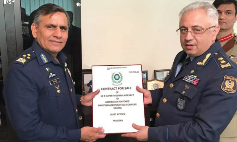 Air Marshal Arshad Malik, chairman of the Pakistan Aeronautical Complex, Kamra, presents a sale contract for Super Mushshak aircraft to Azerbaijan Air Force Commander Lt Gen Ramiz Tahirov.—INP