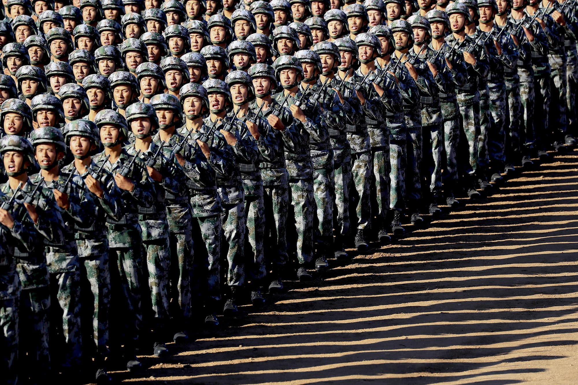 In this photo released by China's Xinhua News Agency, Chinese People's Liberation Army (PLA) troops march in formation Sunday, July 30, 2017 as they arrive for a military parade to commemorate the 90th anniversary of the founding of the PLA. ─ AP