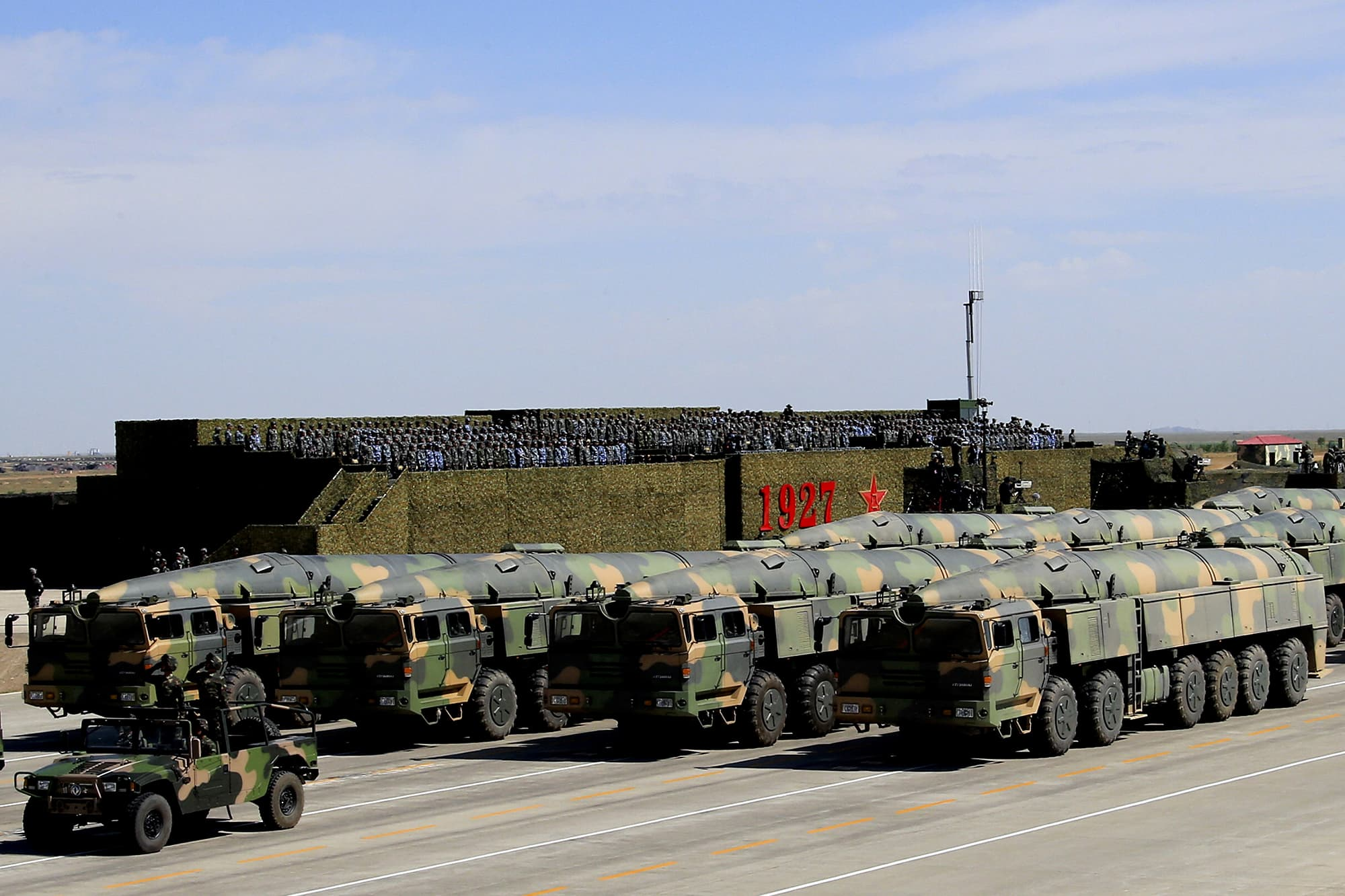 In this photo released by China's Xinhua News Agency, military vehicles carrying missiles for both nuclear and conventional strikes are driven past the VIP stage during a military parade to commemorate the 90th anniversary of the founding of the People's Liberation Army at Zhurihe training base in north China's Inner Mongolia Autonomous Region. ─ AP