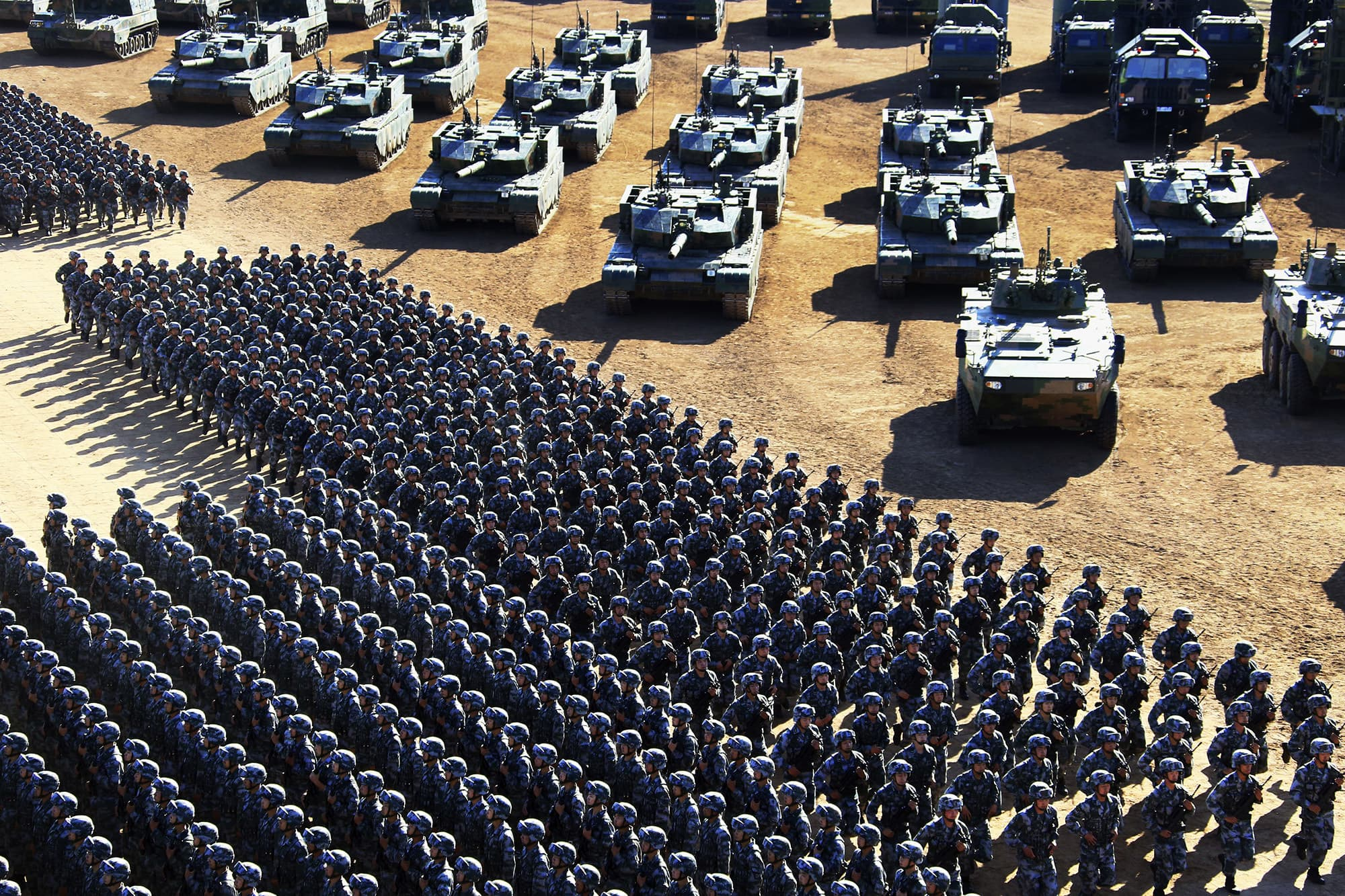 In this photo released by China's Xinhua News Agency, Chinese People's Liberation Army (PLA)  troops march past military vehicles Sunday, July 31, 2017 as they arrive for a military parade to commemorate the 90th anniversary of the founding of the PLA. ─ AP