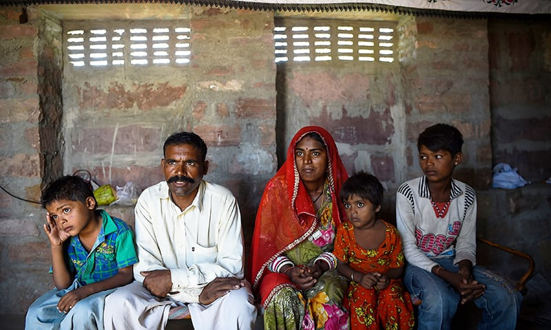 A family of Pakistani Hindus living in an unauthorised settlement in Jodhpur in India's western state of Rajasthan.─AFP