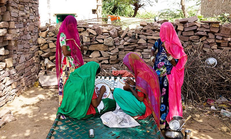 Migrant artisans originally from Pakistan work in Jodhpur in India's western state of Rajasthan.─AFP