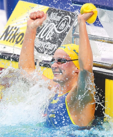 SARAH Sjostrom of Sweden celebrates after winning the women's 50m freestyle final.—Reuters