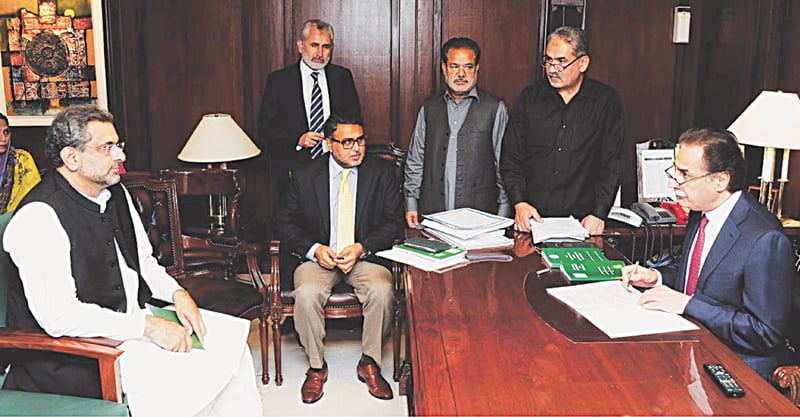 National Assembly Speaker Ayaz Sadiq scrutinises the nomination papers in his chamber at Parliament House on Monday of PML-N MNA Shahid Khaqan Abbasi for election of the prime minister.—Online