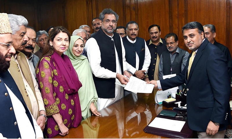 PML-N's Shahid Khaqan Abbasi submits his nomination papers for prime minister to National Assembly Secretary Jawad Rafique Malik at Parliament House.— Online