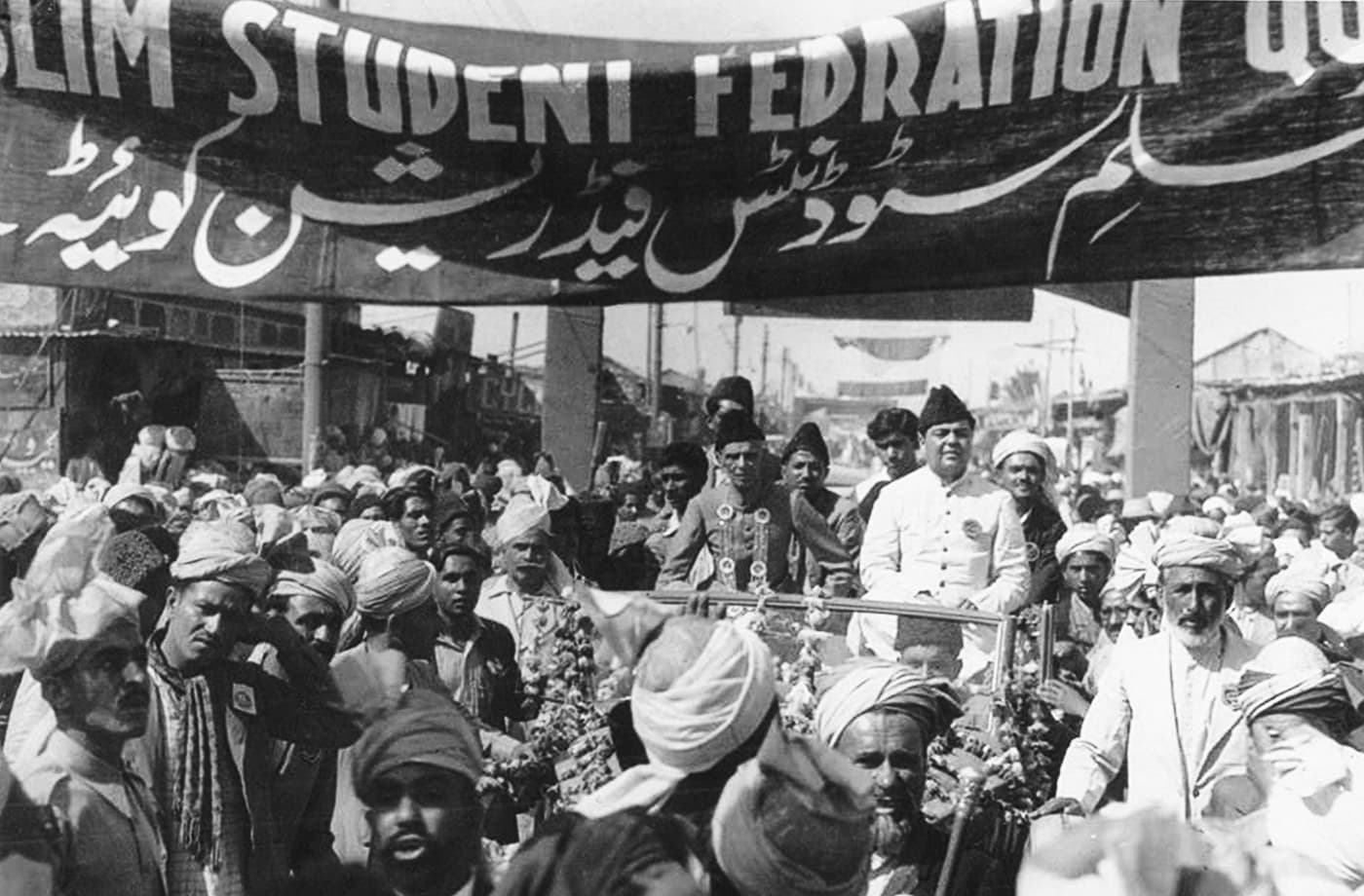 Quaid-i-Azam Mohammad Ali Jinnah and Qazi Isa are cheered by the Muslim Student Federation in Quetta. — Courtesy National Archives Islamabad