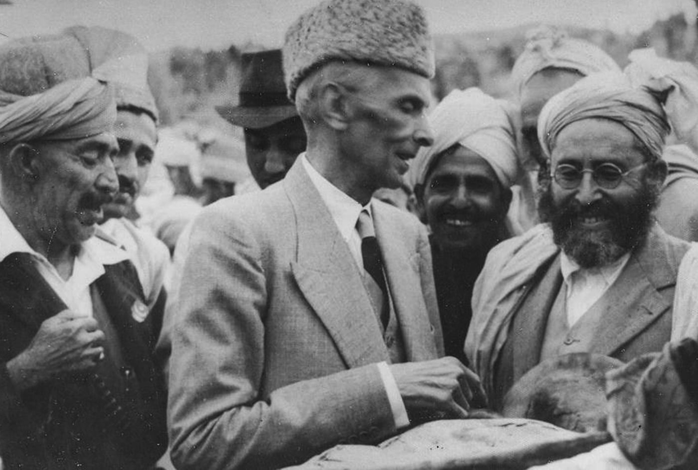 Quaid-i-Azam Mohammad Ali Jinnah is presented with a traditional loaf of bread in Peshawar by Afridi chiefs in November 1945. — Courtesy National Archives Islamabad