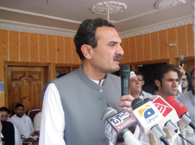 Ameer Haider Hoti addresses a public meeting in Battagram on Wednesday. —Dawn