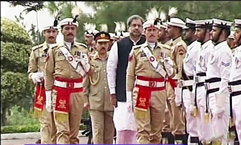 PM Abbasi walks during the parade.— DawnNews